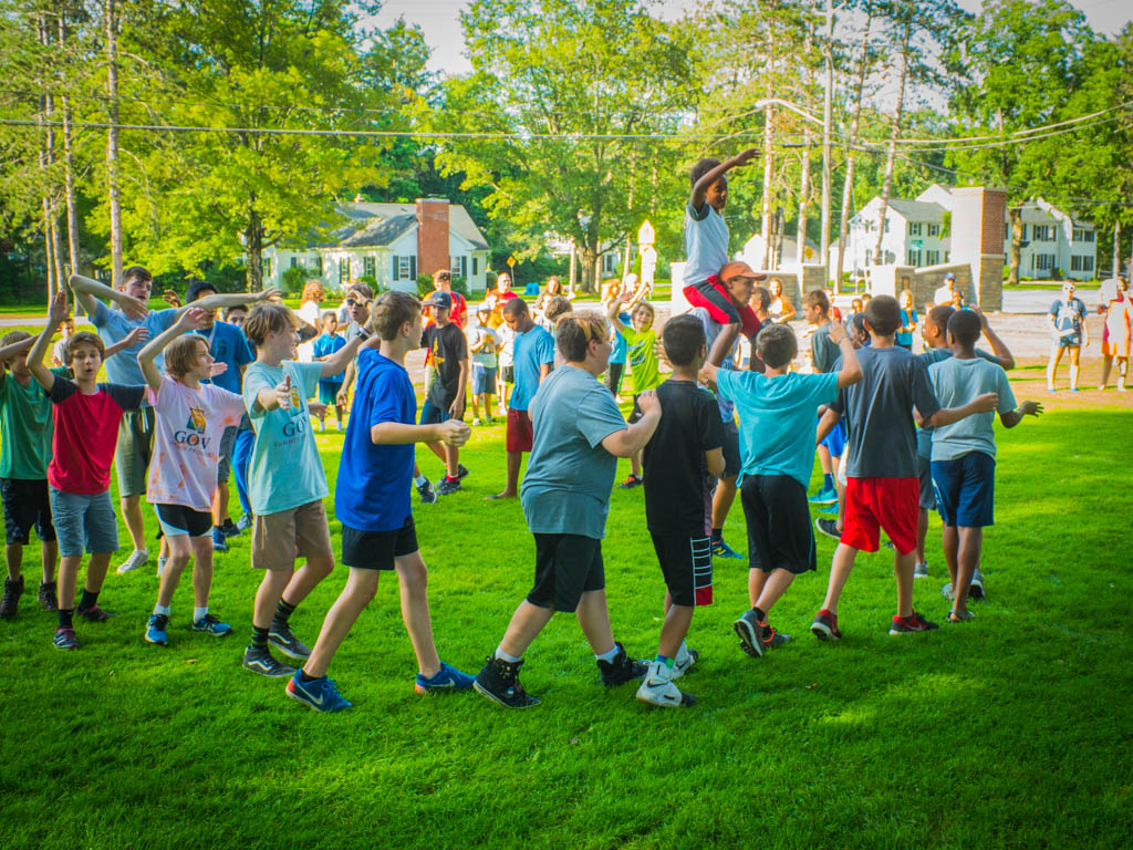 Summer camp students walking in a circle