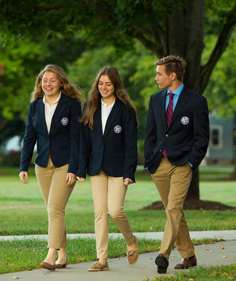 three students walking on Gow School campus