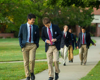 Gow School students walking on campus sidewalk